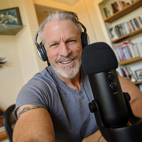 Gary in the home office wearing headphones